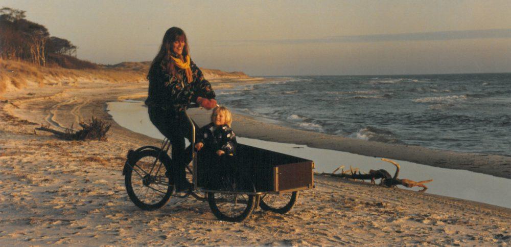 Riding cargo bike on beach