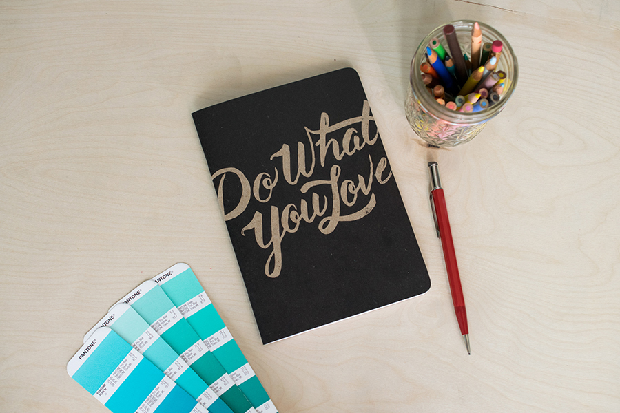 "Custom notebook with a black cover and the words ""Do What You Love"""