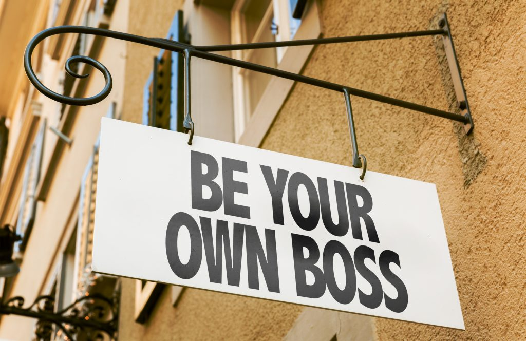 A sign with the words Be Your Own Boss
