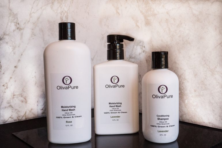 Bottles of OlivaPure shampoo and handwash